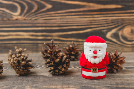 Santa Claus Toy on Wooden Backdrop. Merry Christmas and Happy New Year Concept Stock Photo