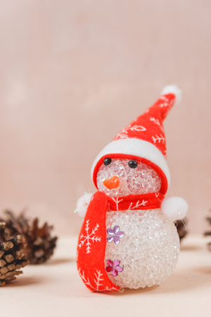 Snowman Toy on White Wooden Backdrop. Merry Christmas and Happy New Year Concept Stock Photo