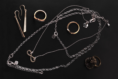 neckless: A collection of jewelry on black background