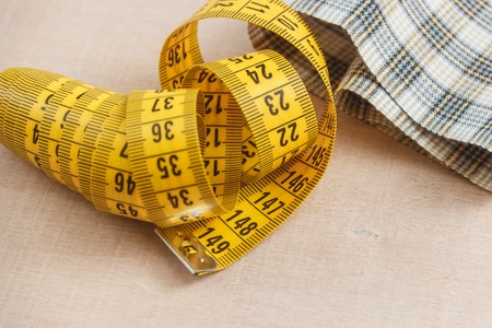 Curved measuring tape. Closeup view of yellow measuring tape. Stock Photo