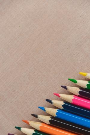 Colour pencils on wooden texture background