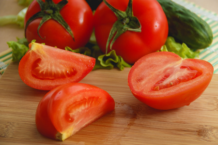 cutted: cutted tomato, cucumber vegetable and salad. Health care food. Stock Photo