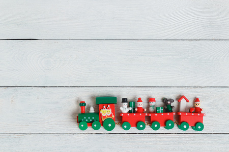 A colorful holiday Christmas train over a white background Stock Photo