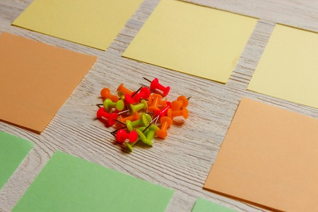 Stationary, Blank Colored Sticker, Pushpins Heap on White Wooden Board. Time-management, Planning. Stock Photo