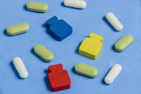Assortment of Pills, Tablets and Capsules on Blue Table. Stock Photo