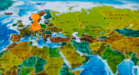 Travel Destination Points on World Map Indicated with Colorful Thumbtacks and Shallow Depth of Field Stock Photo