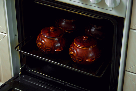 Traditional Russian ceramic pots for cooking in oven.
