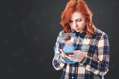 GDPR concept image. General Data Protection Regulation, the protection of personal data. Young woman with smartphone.