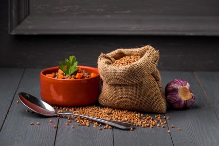 Bowl of tasty buckwheat porridge on table.