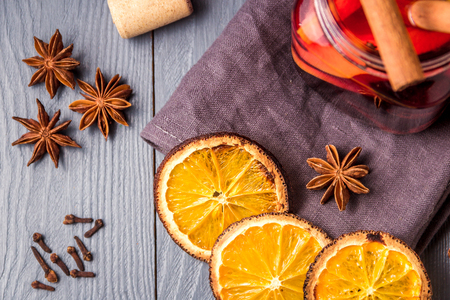 Mulled wine and spices on gray wooden background. Selective focus. Top view. Stock Photo