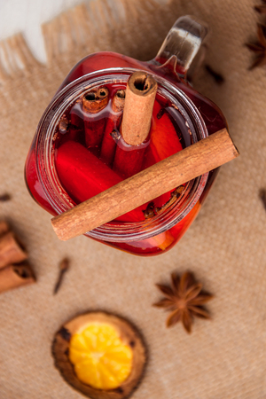 Mulled wine and spices on white wooden background. Selective focus. Top view. Stock Photo
