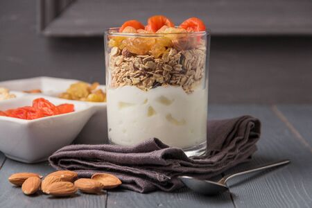 Homemade yogurt with granola, dried fruit and nuts bio with most healthy seed.