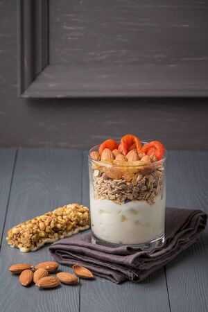 Homemade yogurt with granola, dried fruit and nuts bio with most healthy seed with copyspace. Reklamní fotografie
