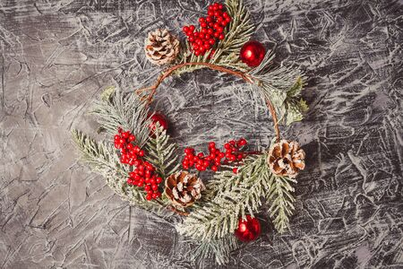 christmas wreath on concrete background. Christmas decor self made. Stock Photo