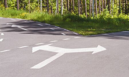 Running track with fork sign on asphalt in park. Concept Business Decision way. Stock photography.