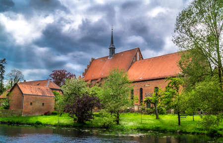 Klostergebeude nit dunkler Himmel Stock Photo