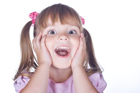 surprised child: cheerful girl holding her cheeks with her hands Stock Photo