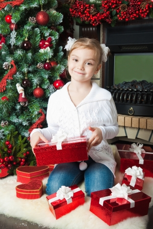 Happy little girl in with gifts photo