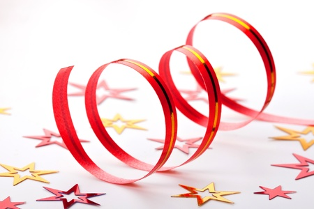Red ribbon and confetti on white background Stock Photo