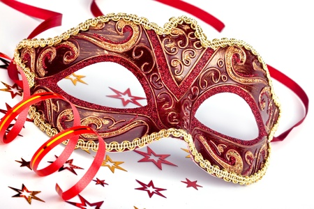 Red masquerade mask with confetti and streamer Stock Photo