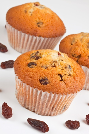 sweet bun: Muffins and  raisins on a white background Stock Photo