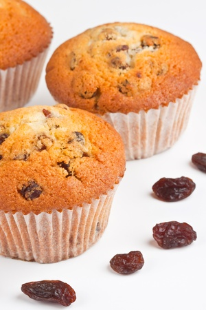 Muffins and  raisins on a white background Stock Photo