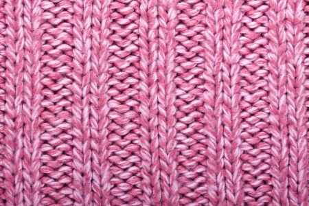 Lilac color wool knitted background closeup