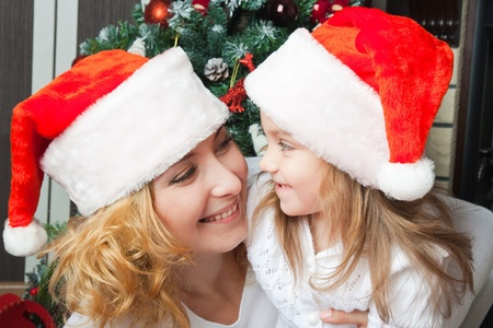 Happy mother and daughter celebrating christmas