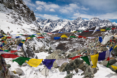 Prayer flags in the mountains. Cho La Pass. Himalayas. Nepal photo