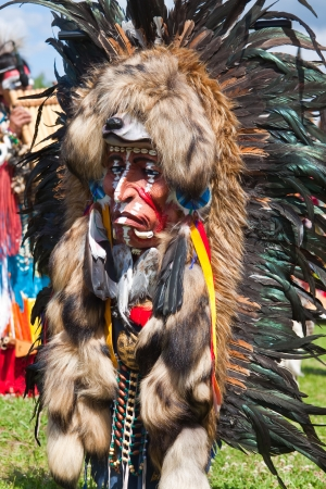 Redskin mask with feathers and animal fur photo