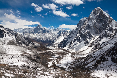 Mountains Ama Dablam, Cholatse, Tabuche Peak at the blue sky with clouds on a sunny day photo