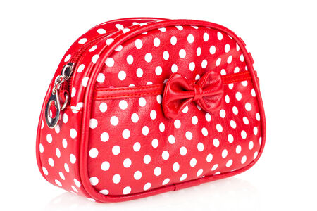 Red makeup bag isolated on white photo