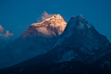 Sun rays on the mount Ama Dablam (6814 m) at sunset. Himalayas. Nepal