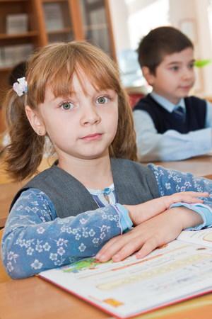Elementary school. Schoolgirl with a book