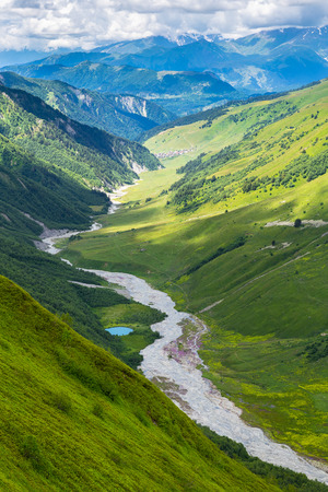 Beautiful landscape with a river and a small blue lake in Caucasus mountains