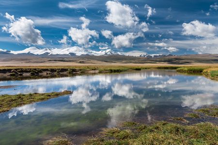 Beautiful mountain landscape with river and clouds. Plateau Ukok, Altai