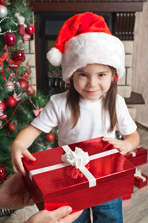 Christmas gift from father for little daughter in Santa hat