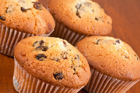 Four muffins on the table Stock Photo
