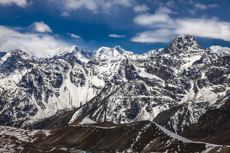 Rocky mountains at the blue sky with clouds. Himalayas Stock Photo