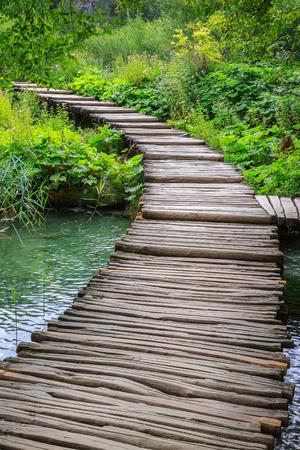 Wooden bridge footpath over the lake. Croatia Stock Photo