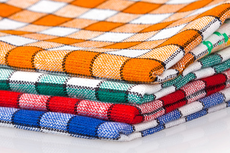 Colored kitchen towels on a white background