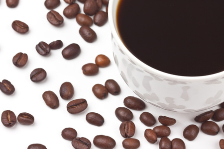 A cup of coffee on coffee beans background Stock Photo