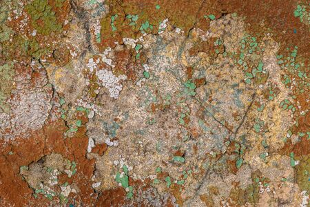Texture of cracked old paint on a stone wall. Background