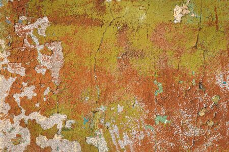 Fragment of an old wall with scratches and cracks in the paint. Background