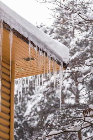 Icicles hang from the roof. Winter concept Stok Fotoğraf