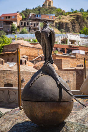 TBILISI, GEORGIA - July 16, 2014: Sculpture of Falcon and Pheasant. Historical Abanotubani district. Old Town of Tbilisi