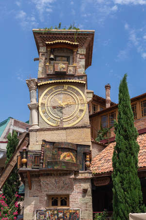 TBILISI, GEORGIA - July 27, 2014: Beautiful Clock Tower of puppet theater Rezo Gabriadze in historical center of old Tbilisi