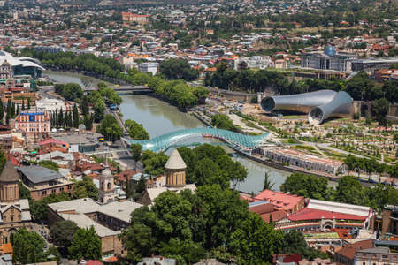 TBILISI, GEORGIA - July 16, 2014: Panoramic view of Tbilisi to bridge of Peace and Kura River in the afternoon on a summer day. Georgia Editöryel