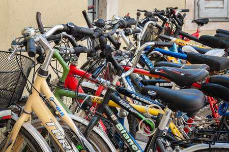 ROVINJ, CROATIA - August 22, 2012: Plenty bicycles at parking lot near the old building