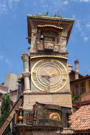 TBILISI, GEORGIA - July 27, 2014: Falling Clock tower of puppet theater Rezo Gabriadze in old town of Tbilisi